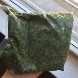 Opened pack of frozen Molokhia