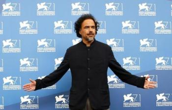 """Director Alejandro Inarritu poses during the photo call for the movie """"Birdman or (The unexpected virtue of ignorance)"""" at the 71st Venice Film Festival"""