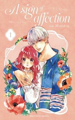 Les deux personnages se tiennent rapprochés et cote à côte, la couverture est dans des tons rosés doux