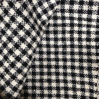 dicke, schwarz-weiße Webware aus unbekannter Mischung - wahrscheinlich Poly/Wolle