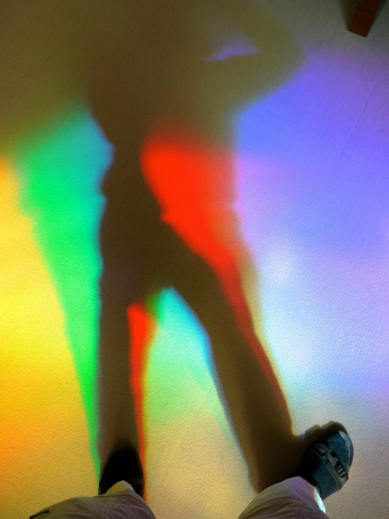 A library visitor creates his own living rainbow shadows!