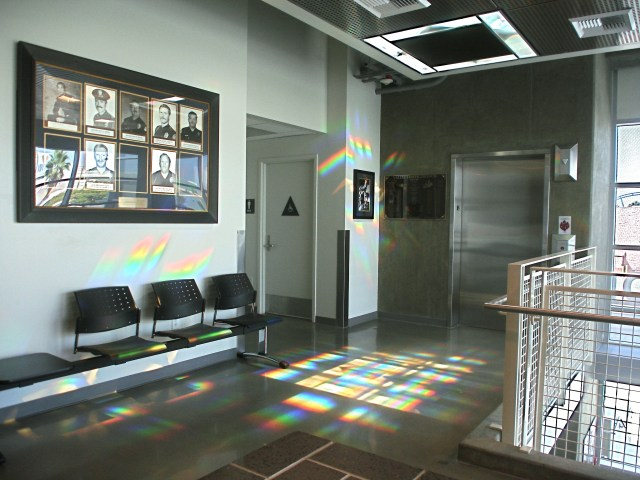 wide angle view of lobby with solar spectrum splashes on walls and elevator of rainbow light art. Erskine Solar Art