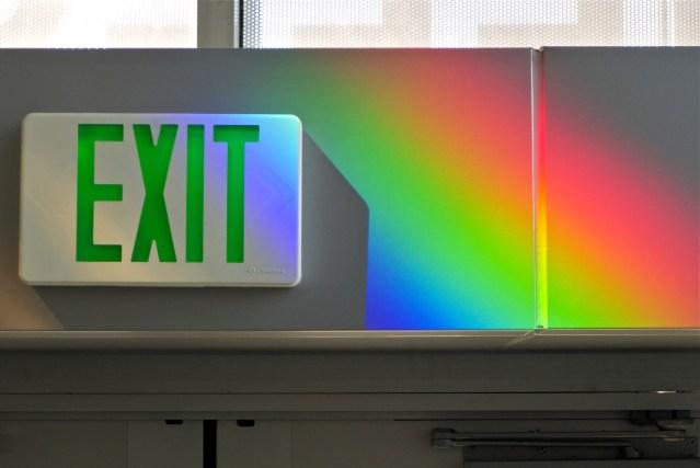 Solar rainbow prisms paint the exit sign. Erskine Solar Art