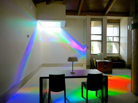 library reading room is splashed with green, blue and magenta solar spectrum light. Erskine Solar Art
