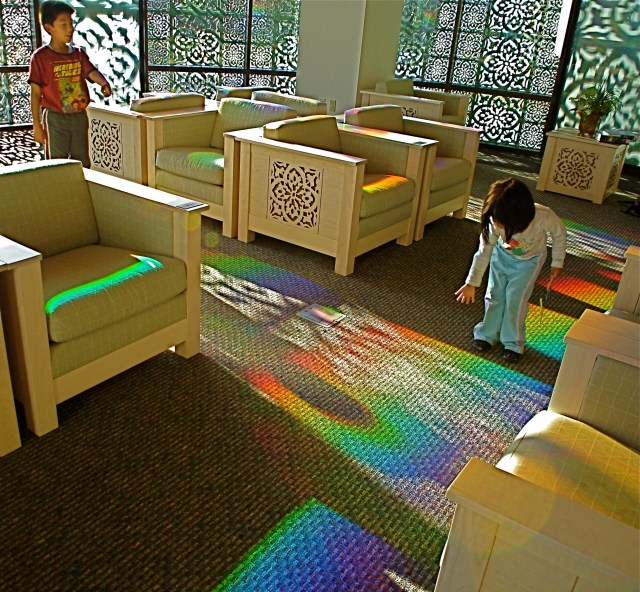 children play in library's solar powered art.