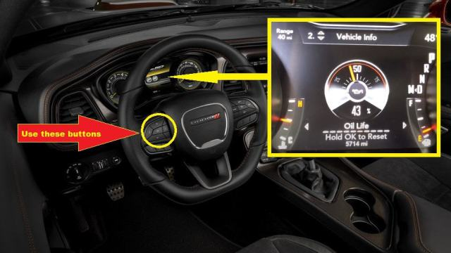 Dodge Challenger Oil Reset - Press the Up arrow button to navigate vehicle information
