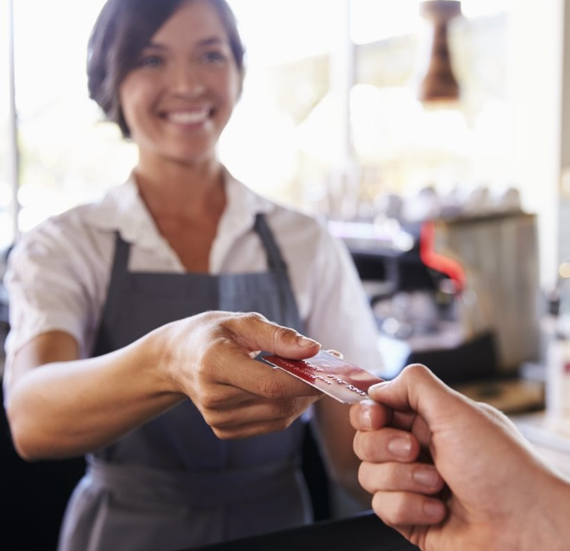 cashier-accepts-card-payment-from-customer