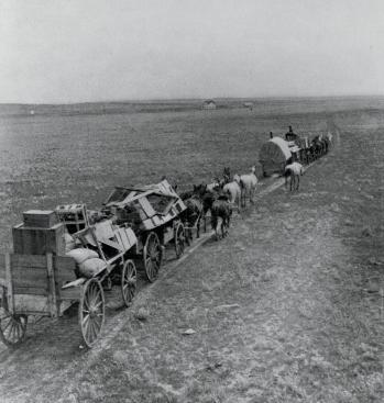 Siedler aus dem USA auf dem Weg in die Westliche Prärie, The Encyclopedia of Saskachewan
