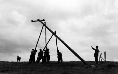 Erecting the poles, one at at time