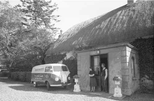 Rural sales van with poster on front advertising a demonstration in St Mary's Hall Mullingar in May 1954