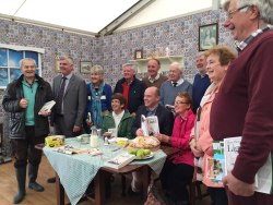 Denis Naughten TD pictured at ESB's model rural kitchen with contributors to the book