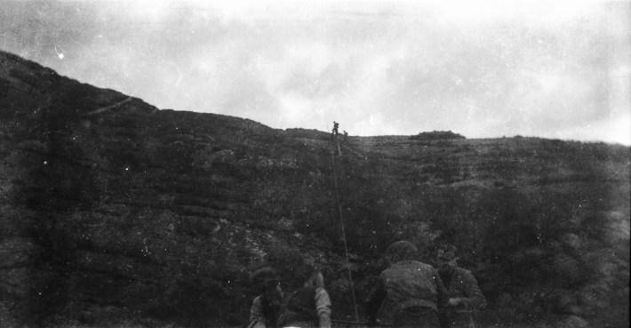 Hard at work: moving poles up steep terrain