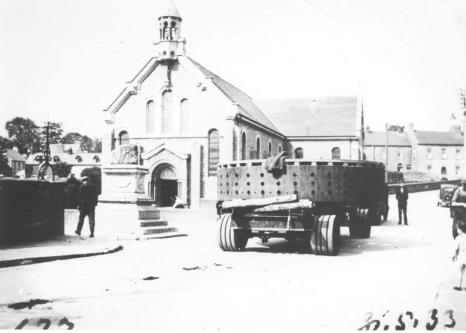 Transport of generator component past the Treaty Stone, May 1933