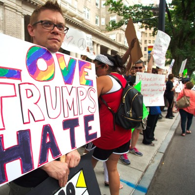 Protestors demonstrate near the historic Fox Theatre before Republican presidential candidate Donald Trump speaks, Wednesday, June 15, 2016, in Atlanta. (AP Photo/Ron Harris)