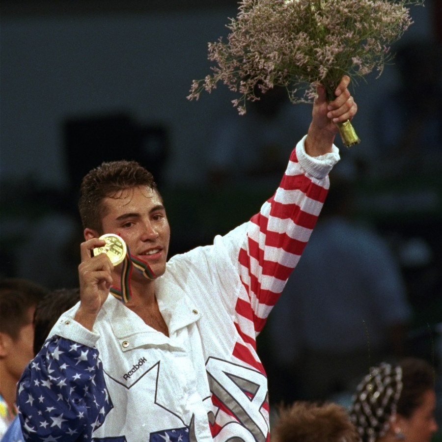 USA's Oscar De La Hoya shows off his gold medal during the award ceremony for lightweight boxing division in the XXV Summer Olympic Games in Barcelona Saturday, August 8, 1992. (AP Photo/Mark Duncan)
