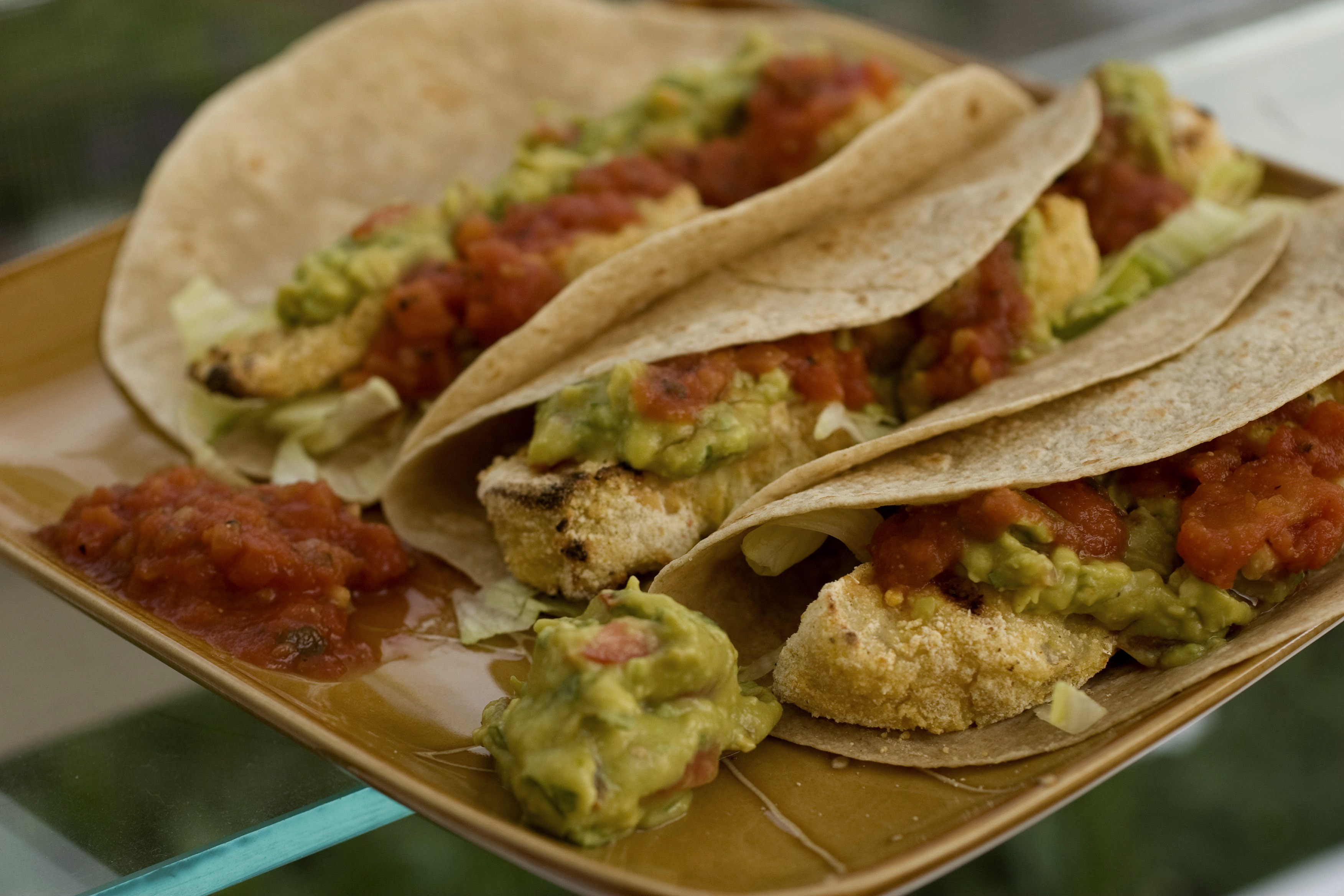 Lightly breaded mahi-mahi is grilled to crunchy perfection for these Grilled Fish Tacos With Guacamole. Like most Mexican food the ingredients are completely adaptable to your favorites. (AP Photo/Larry Crowe)