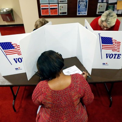Last minute voters rush to cast their ballots on Election Day at the Christ United Methodist Church precinct in north Jackson, Miss., Tuesday, Nov. 8, 2016. (AP Photo/Rogelio V. Solis)
