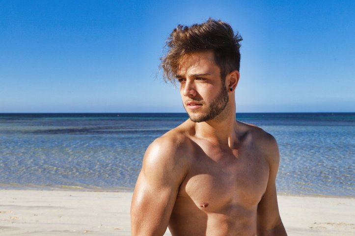 Luca Haenni shirtless on the beach