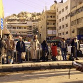 "A bus queue: ""[We] have made you into nations and tribes, so that you might come to know one another"" (49:13) [downtown Amman, Jordan]."