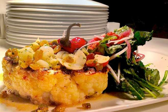 Wow-- at Dish Restaurant, chef Garreth Dickey's grilled cauliflower steak with cipollini onions, baby kale, Calabrese peppers, black radish, golden raisins and brown butter is a vegetarian stunner.