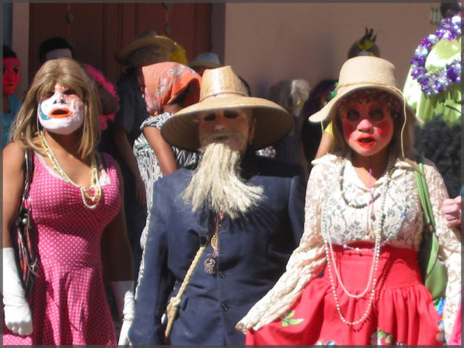 Male and female Carnival costumes on parade participants in Ajijic.