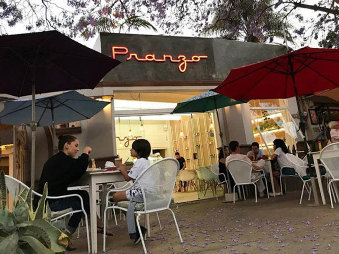 Ajijic restaurant, Pranzo Bistro's outdoor seating area with patrons sitting under colourful patio umbrellas.