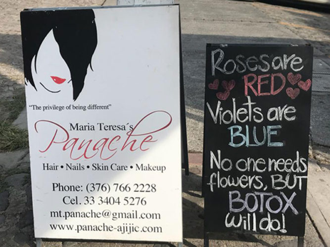Panache Hair and Skincare Studio sandwich board sign with contact information and blackboard beside it with cute saying