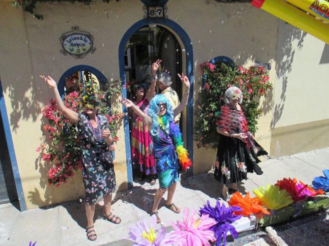 Ajijic people dressed up and watching the Mardi Gras parade during carnival.