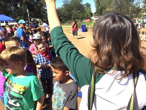 Valley Center Primary teacher Kathy Wollman keeps her second graders, including David Manriquez, under her left arm, in line.