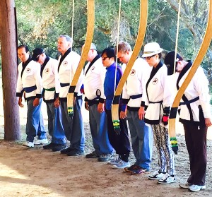 Saturday Kuk Gung class observes traditional Korean ceremony with bows in foreground.