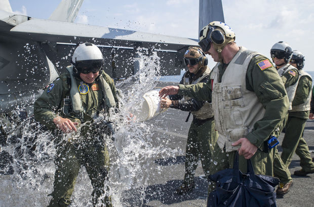 Change of command ceremony with traditional water splash on Lt. Lassen