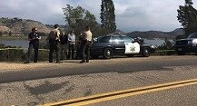 Social media shot of police investigating Lake Hodges body remains Saturday.