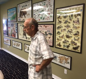 Keith Roynon surveys some of the materials in one of the museum education rooms.