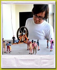 Diorama artist Matt Hebert checks it out.