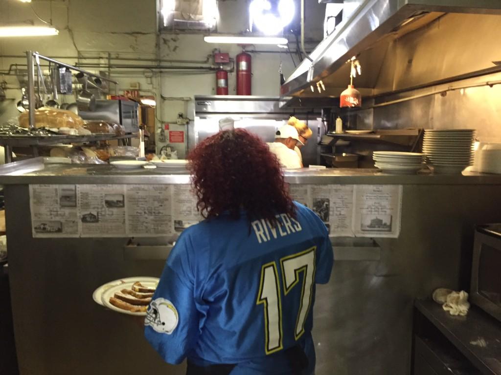 Annette Chapman, cooking, prepares last meals at champion's