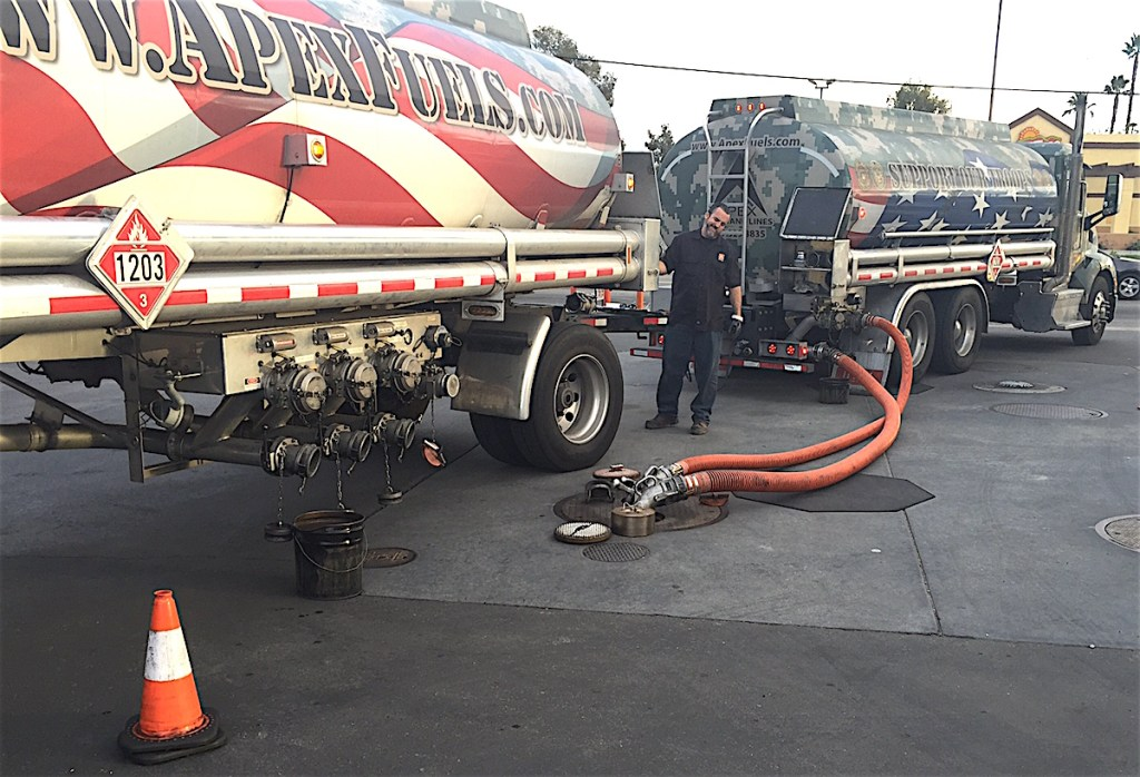 Waiting for Ladeau pays off as tanker driver Adam Ladeau pumps the APEX Fuels third gasoline tanker truck of the day. shipment