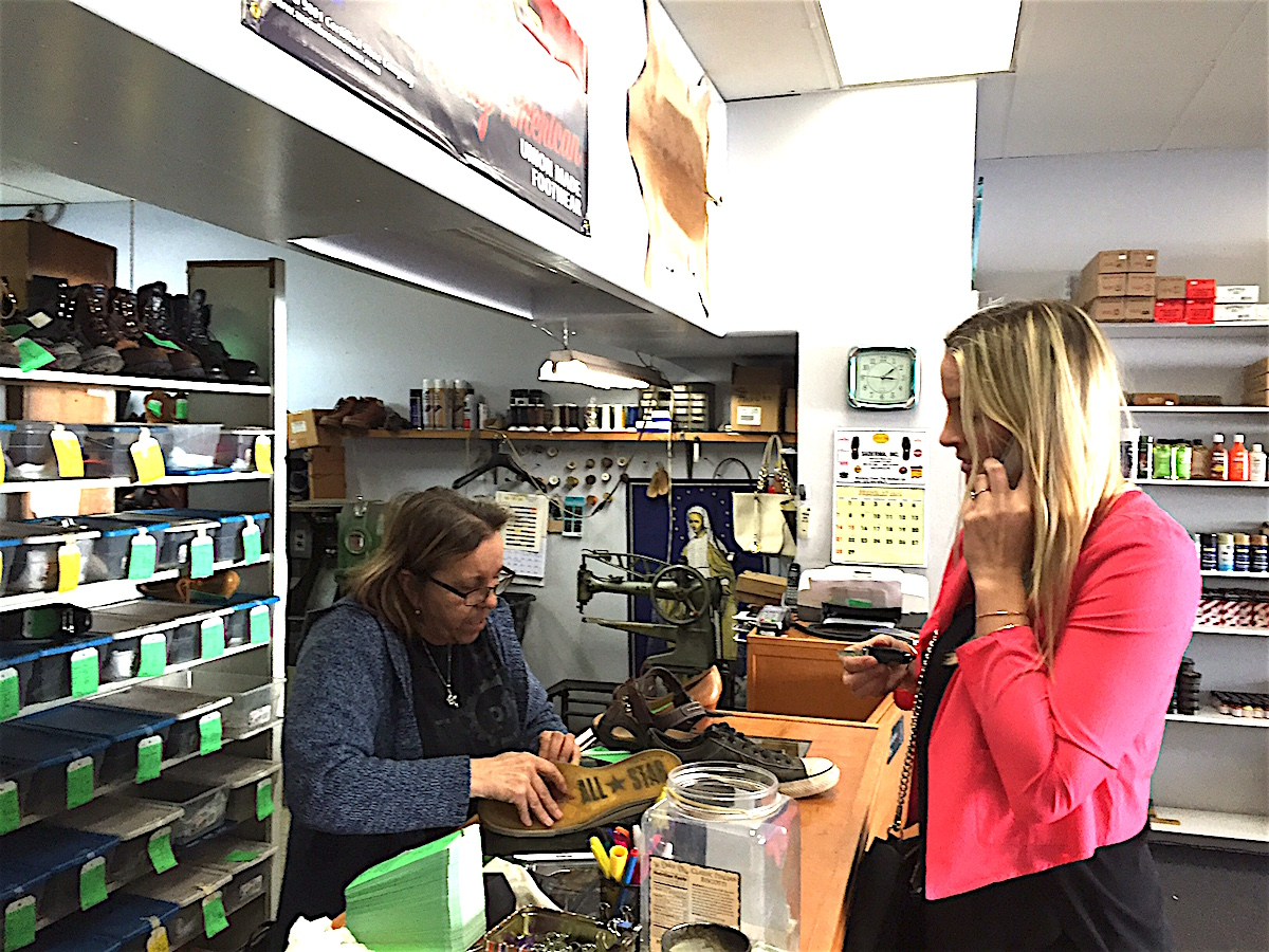 Lucia Capuano checks out a customer's drop-off repair.