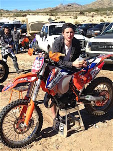 Kyle Hutcheson with his bike at an event.