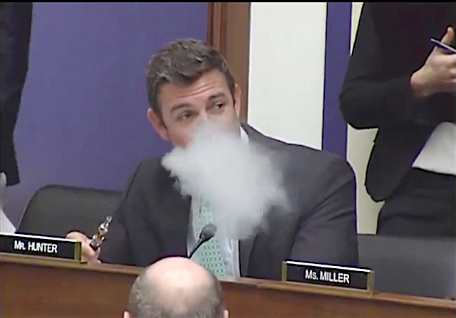 Hunter blowing smoke, er vapor, at a recent House Transportation Committee meeting.