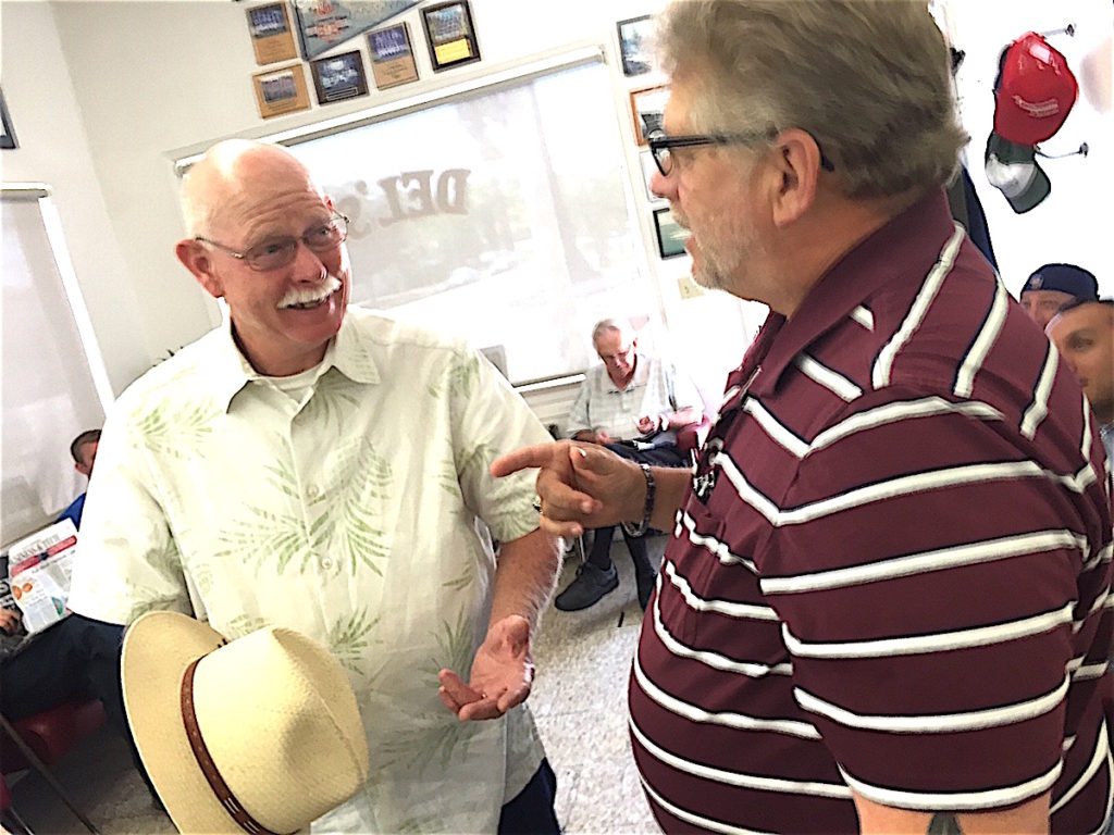 Dan Engelbrecht, left, with long0time -- and who isn't --customer Mike Sherman.