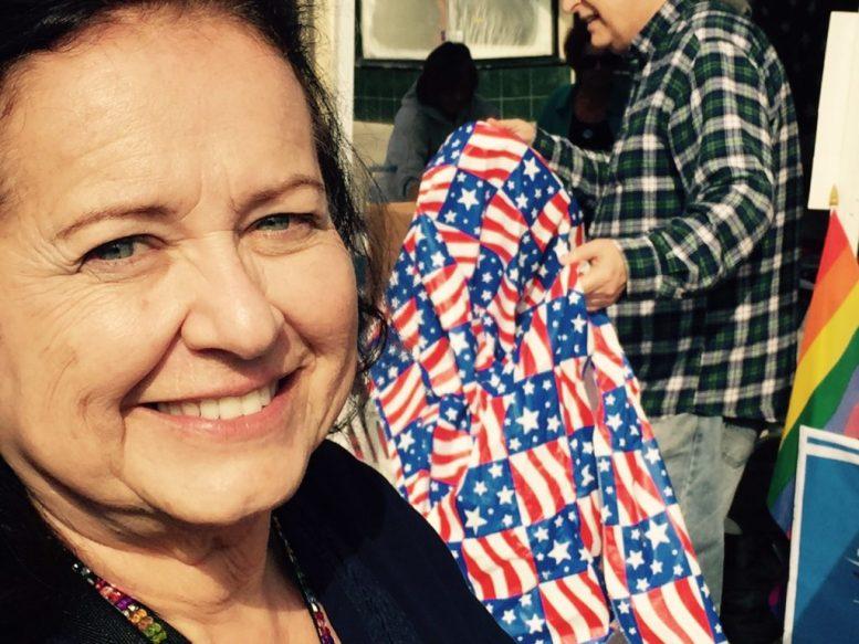 Nina Deerfield of Escondido Alliance/Alianza Escondido by the group's booth at the street fair(e).
