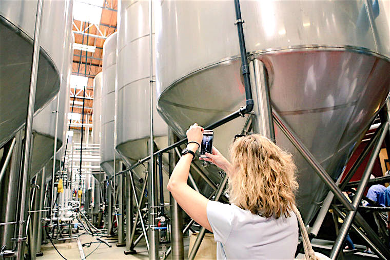 Cyane Crump, the director of Historic Richmond, photographed beer tanks at Stone Brewing's headquarters at Escondido on Thursday, April 21, 2016. Crump was on ChamberRVA's InterCity visit.
