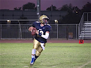 Vincent Memoria QB rolls out against Escondido Charter Friday night at El Centro/Maxpreps photo