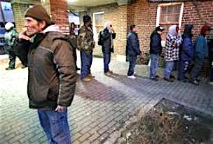 San Marcos homeless line up for supper.