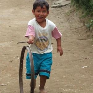 Boy Rolling a wheel
