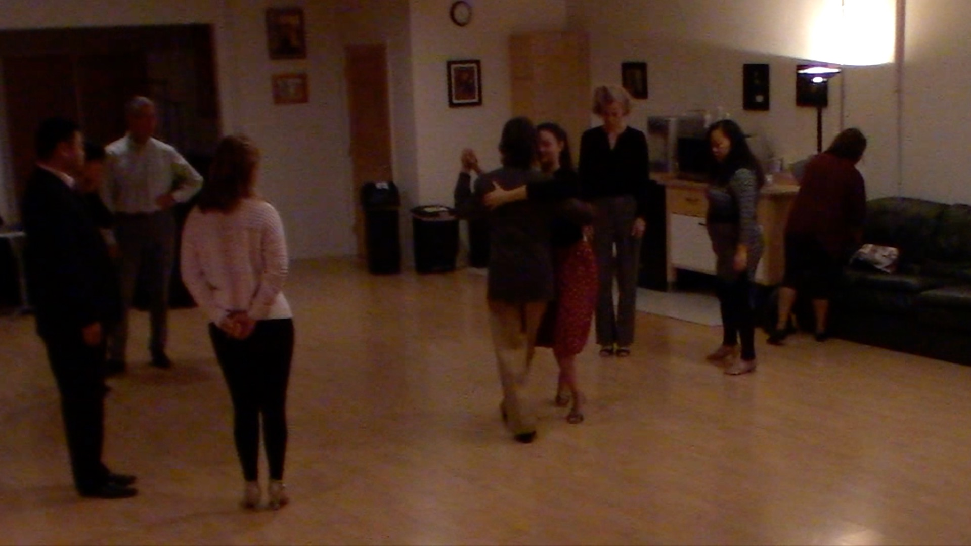 Argentine Tango dance with Miranda teaching backward ocho at beginner's class in San Francisco