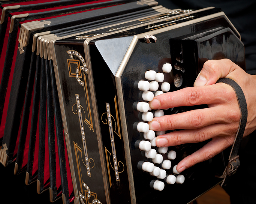 Playing traditional bandoneon, the main instrument of Argentine Tango.