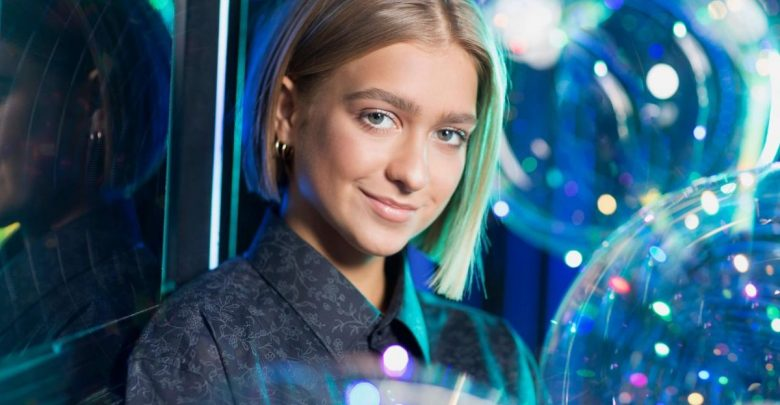 Zena poses as co-host of the Junior Eurovision Song Contest 2018