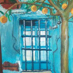 ventana y naranjas