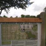 A big sign with a map of the park